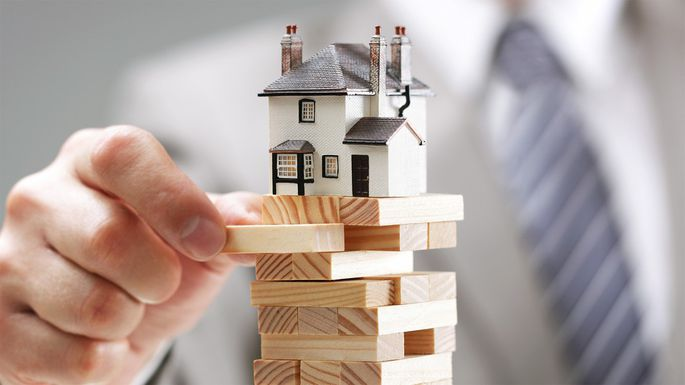 house on jenga pieces representing home insurance