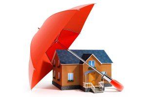 umbrella shielding a house, representing home insurance