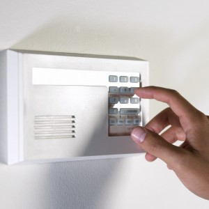 arming & disarming alarm system keeping safe from robbers --- Image by © Royalty-Free/Corbis