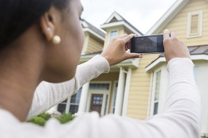 Real estate agent takes photo of house