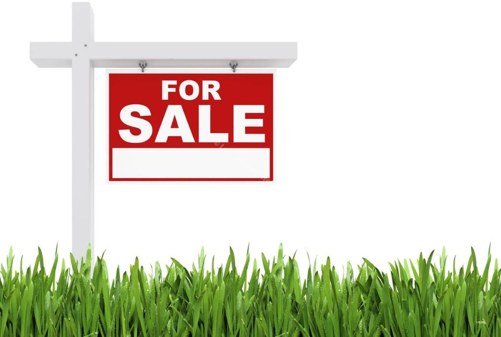 For Sale Sign on a piece of Land | Avoiding Land Litigation Issues in Ghana