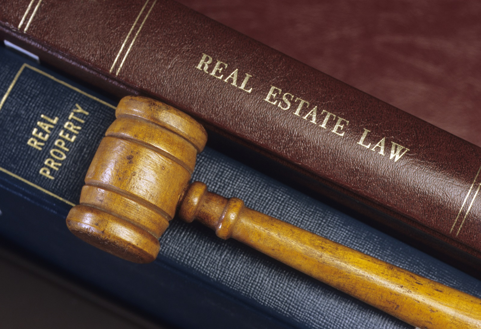 Real Estate Law Books and Gavel | How to Avoid Land Litigation Issues in Ghana
